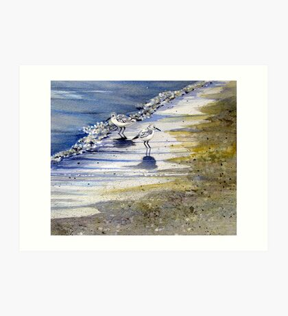 Sandpipers playing in the bubbles at waters edge Art Print