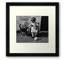 Little girl knitting Framed Print