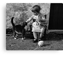 Little girl knitting Canvas Print