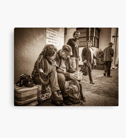 Checking the evening programme  Canvas Print