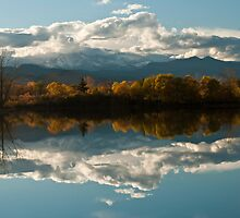 Reflections of Longs Peak, Colorado by Gregory J Summers