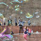 Blowing bubbles in Barcelona by Chris Allen