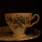 dainty cup and saucer  by Jeff Stroud