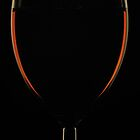 Wine in Wine Glass on Black by edge2edgephoto