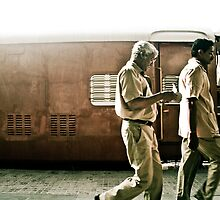 Indian man walking in the train station by misskim
