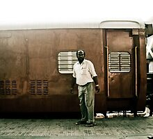 Man waiting for the morning train by misskim