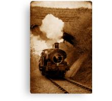 Steam train going under bridge, Shepton Mallet, Somerset, UK Canvas Print