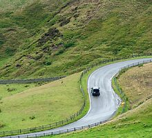 S-bend on a rural road passing through the Peak District National Park by stuwdamdorp