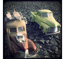 two matchbox trucks on the road Photographic Print