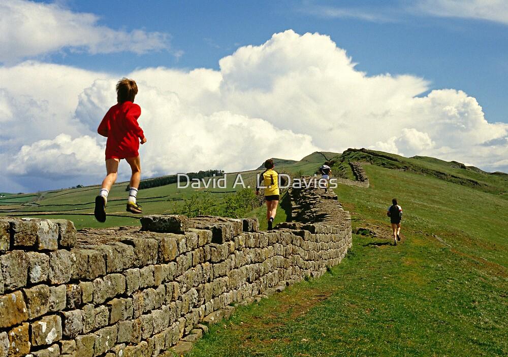 Children running along Hadrian's Wall, England, UK,1980s by David A. L. Davies