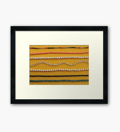 Multi colored beads Framed Print
