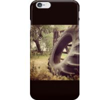 Tractor Tire Under Some Willow Trees iPhone Case/Skin