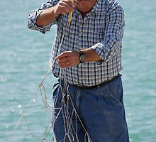 Mending the nets, Port of Sciacca, Sicily by Andrew Jones