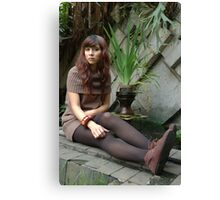young lady sit down in park Canvas Print