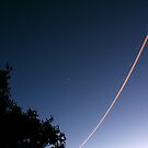 Night Jet Light Trail by Raoul Isidro