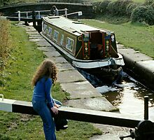Narrow boat passing through one of the Bosley locks on the Macclesfield Canal near Congleton, UK in the 1970s by David A. L. Davies