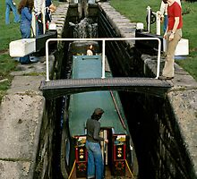 Narrow boat entering a lock on the Macclesfield canal, Cheshire, UK (1970s) by David A. L. Davies