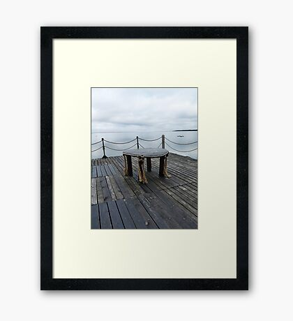 Table on the pier Framed Print