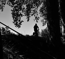 a cyclist on the bank by ragman