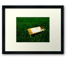 Golden iPhone on the lawn Framed Print