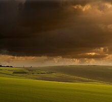 Stunning storm clouds over sunlit countryside by Veneratio