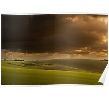 Stunning storm clouds over sunlit countryside Poster