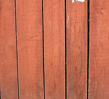 Wood planks closeup with peeling paint red by vladromensky