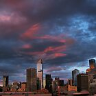 Sunset over the city. by Robyn Lakeman