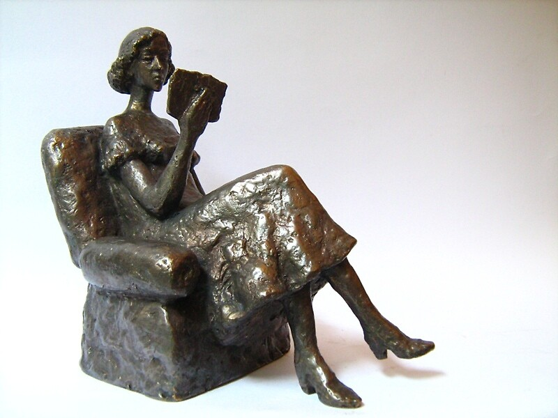 Girl with book by Milen