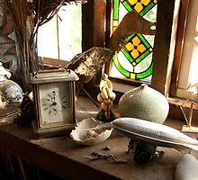 Steampunk Still-Life with Coach Clock and Toy Zeppelin by Diane Nemea Laessig