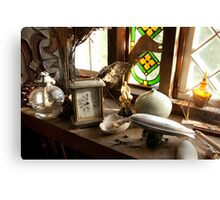 Steampunk Still-Life with Coach Clock and Toy Zeppelin Canvas Print