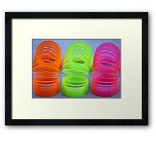 Neon Slinkies Framed Print