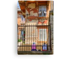 Women sitting on street outside Colosseum in pula Canvas Print