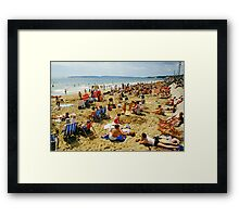 A busy Bournemouth beach (2), England, 1980s Framed Print