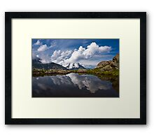 Trolls' clouds reflecting in Norwegian mountain lake. Framed Print