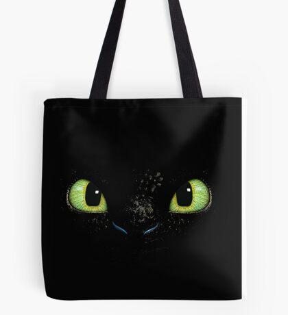 Toothless fiery eyes Tote Bag