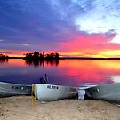 Sunrise with Boats by Debbie  Maglothin