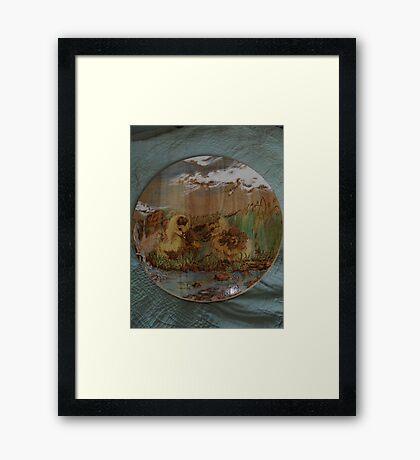 ducklings over dandelion by the stream Framed Print