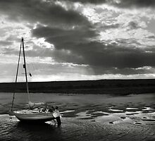 Yacht at low tide - Burnham Overy Staithe, Norfolk, UK by Richard Flint