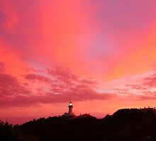 lighthouse at sunrise by michelle mcclintock