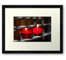 Candles in red holders Framed Print