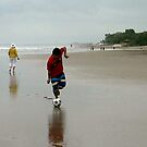 soccer by the sea shore by geof