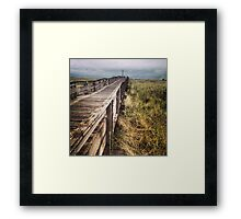 Walking Bridge to Gray Skies Along Beach Framed Print