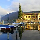 The little harbor in Iseo in the evening by annalisa bianchetti