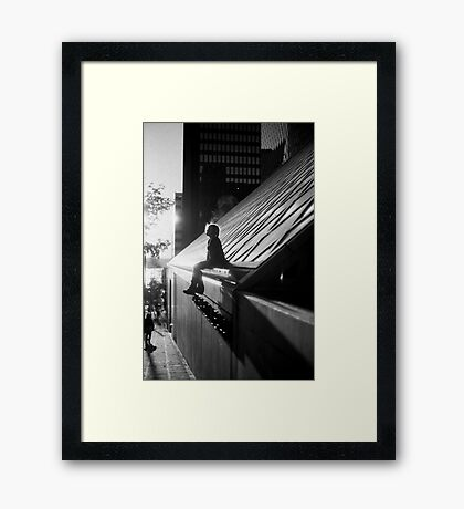 Silhouette of girl sitting Framed Print