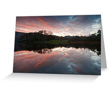 Reflecting on a beautiful sunrise over Derwent water Greeting Card