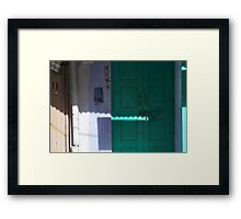 sunlight on a green door Framed Print