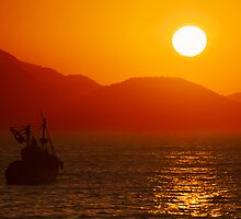 Fishing boat at sunrise by grcav