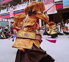 tibetan dancer. north india by tim buckley | bodhiimages