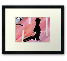 boy with sled Framed Print
